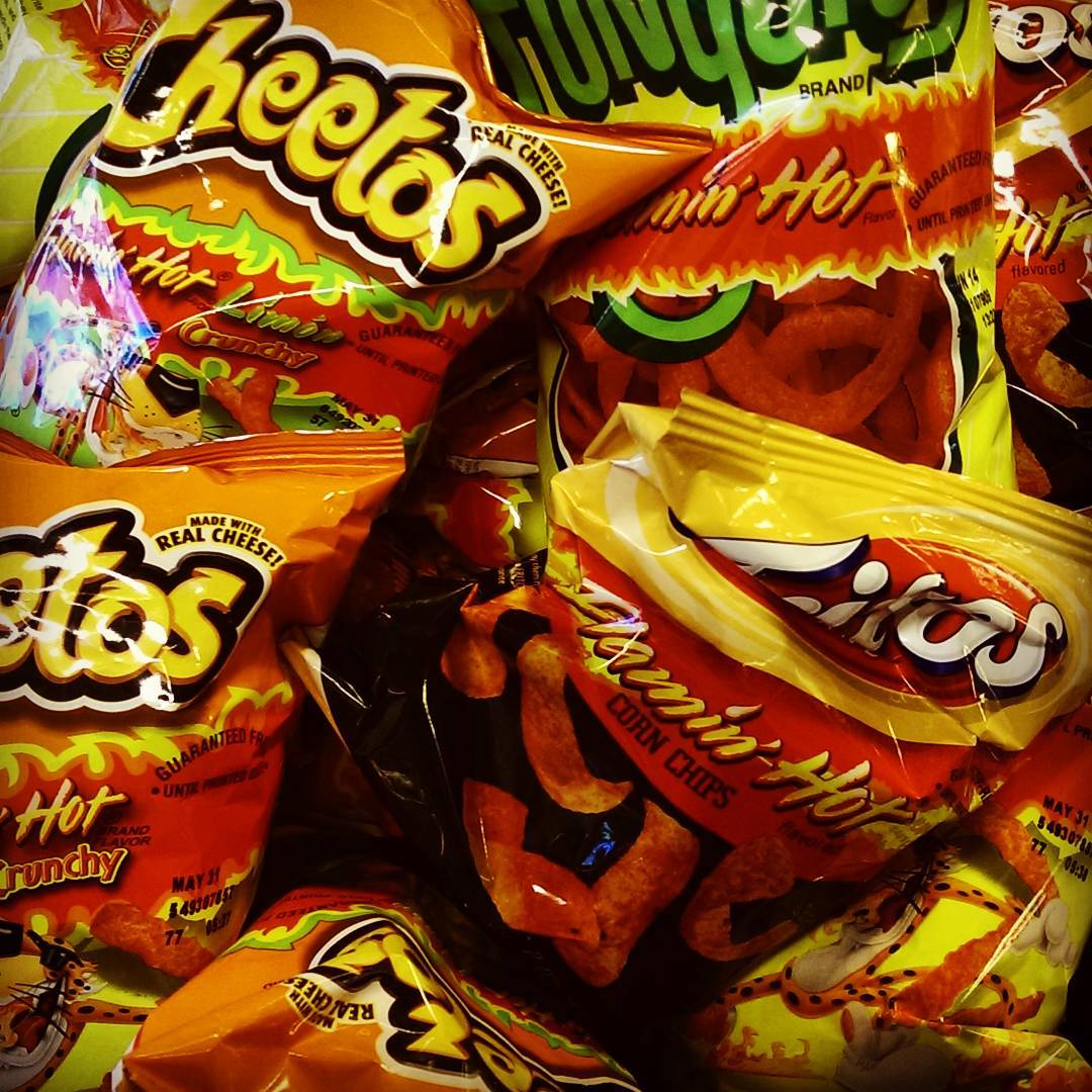 Just restocked the #office #snack supply. We almost died when we found the box of #flaminghot #cheetos #fritos and #funyuns